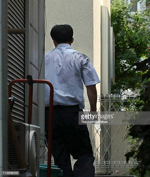A member of armed pickpocket group escape with a knife and a tear gas spray on June 24 2004 in Tokyo Japan