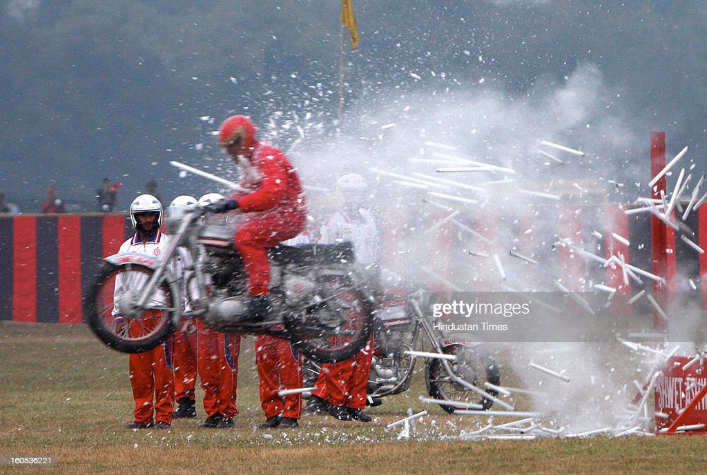 A member of Army Dare Devil Motorcyclist showing his skills during 'Army Equipment Display and Military Tattoo' at Army Polo Ground, Race Course on February 2, 2013 in Kolkata, India.