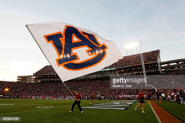 A member of Auburn Tigers cheer team waves a flag during their game against the Alabama Crimson Tide at JordanHare Stadium on November 30 2013 in...
