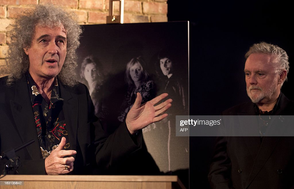 Member of British rock band Queen, Brian May (L), talks next to bandmate Roger Taylor (R) during a ceremony in which Queen were awarded the PRS for Music Heritage Award at Imperial College London in London on March 5, 2013. A plaque was unveiled during the ceremony at Imperial College London, marking that Queen played their first public gig in the Student Union there on July 18,1970. AFP PHOTO / BEN STANSALL
