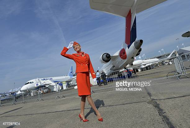 A member of Cabin crew of the Russian airline Aeroflot salutes to visitors during the International Paris Airshow at Le Bourget on June 16 2015 AFP...