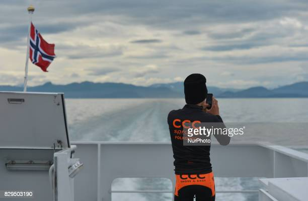 A member of CCC Sprandi Polkowice team takes a photo from the boat from Harstad to Andorja Island on the way to the first stage starting point on...