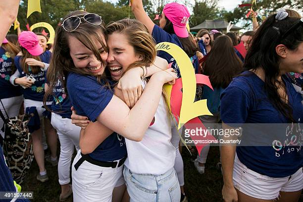 A member of Chi Omega sorority hugs a new member on bid day at George Washington University on the National Mall in Washington on Tuesday October 6...