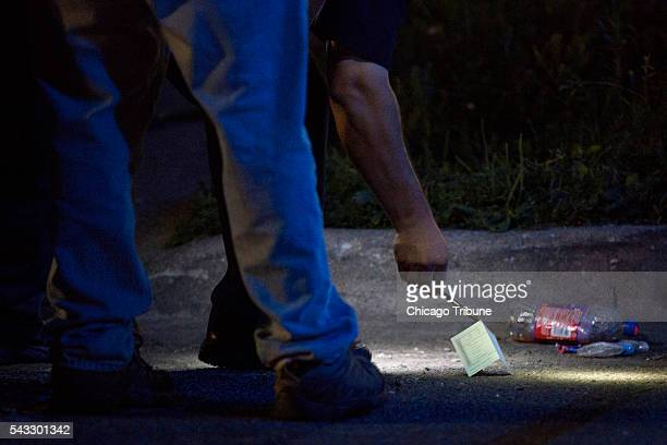 A member of Chicago Police Department looks at evidence at the scene of a fatal shooting in the 700 block of North Ridgeway Avenue Sunday June 26 in...