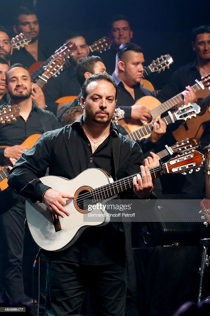 Member of 'Chico & The Gypsies' and grandson of Manitas de Plata, Kema performs whyle the Concert of 'Chico & The Gypsies' with 50 gypsy guitars at L'Olympia on April 15, 2014 in Paris, France.