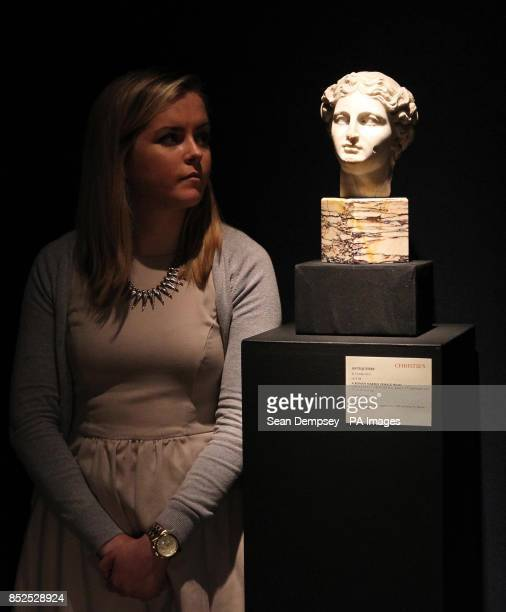 A member of Christie's staff looks at a Roman Marble Female head with an estimate of pound15000pound20000 which is part of a collection of...