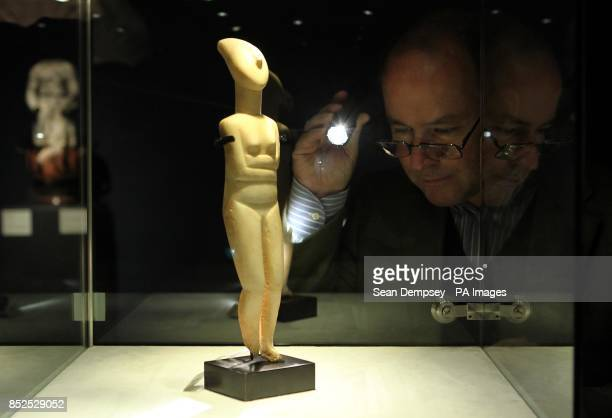 A member of Christie's staff looks at an early Greek Cycladic marble reclining female with an estimate of 120000180000 which is part of a collection...