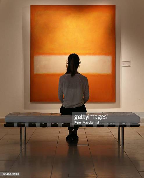 A member of Christie's staff looks at Mark Rothko's's 'No 11 ' on October 14 2013 in London England The work forms part of Christie's New York...