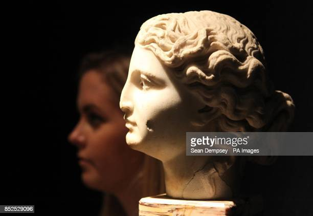 A member of Christie's staff with a Roman Marble Female head with an estimate of pound15000pound20000 which is part of a collection of antiquities...