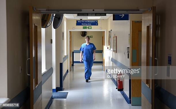 A member of clinical staff walks along a corridor in the the Accident and Emergency department of the 'Royal Albert Edward Infirmary' in Wigan north...
