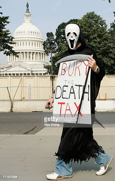 A member of College Republicans National Committee dresses as Grim Reaper as he marches on Capitol Hill to call on the Senate to eliminate the death...