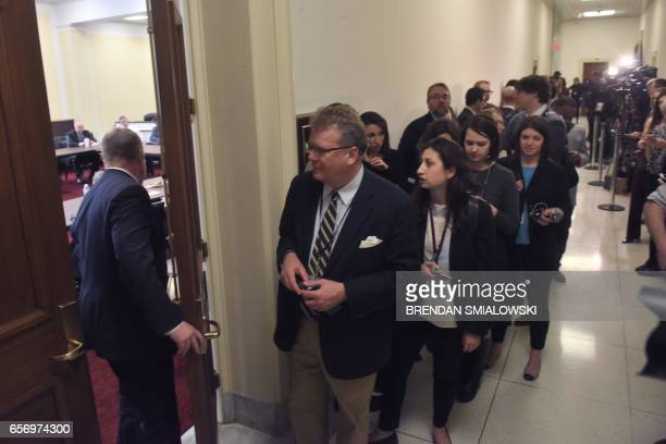 A member of Congress enters a meeting of the Republican Freedom Caucus as journalists wait in the hallway at Congress at the Capitol in Washington DC...