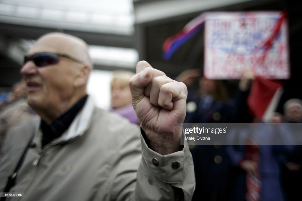 A member of Czech opposition Communist (KSCM) party raises his fist during the popular communist song 'International' as he celebrates May Day on May 1, 2013 in Prague, Czech Republic. In addition to celebrations across the globe of the beginning of spring throughout the world, workers are gathering in city centers to annually vent their grievances and support their worker's unions.