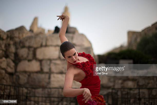 A member of 'Dressed to Dance' rehearses befoer their show at Tower Of David on May 29 2013 in Jerusalem's old city Israel The show will feature...