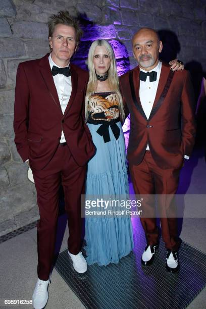 Member of 'Duran Duran' John Taylor his wife Gela and stylist Christian Louboutin attend the 'Liaisons au Louvre IV' Evening of patronage for the...