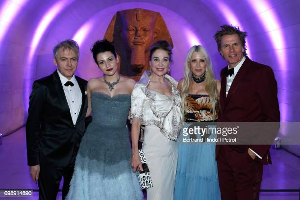 Member of 'Duran Duran' Nick Rhodes his companion Nefer Suvio Becca Cason Thrash John Taylor and his wife Gela attend the 'Liaisons au Louvre IV'...