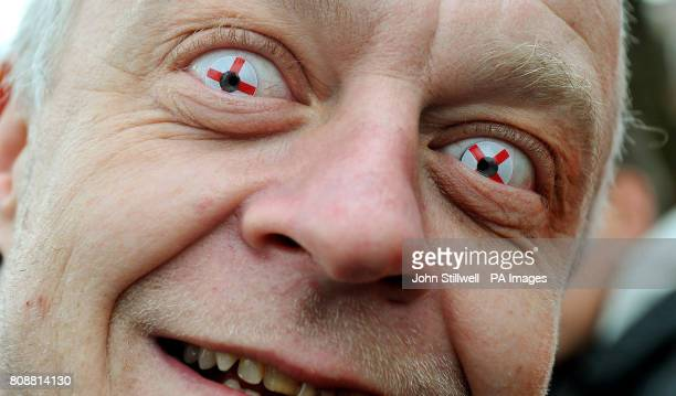 A member of English Defence League wears his patriotic contact lenses before the march into St George's Square Luton this afternoon