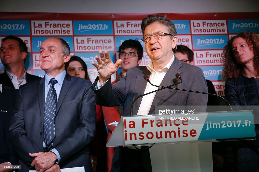 Member of European parliament for the French leftist Parti de Gauche (PG), founder of the 'La France Insoumise' (Unsubmissive France) movement, and candidate for the 2017 French presidential election, Jean-Luc Melenchon (2nd R), delivers a speech during a press conference to present his programme ahead of the election, on May 24, 2016, in Paris. / AFP / MATTHIEU