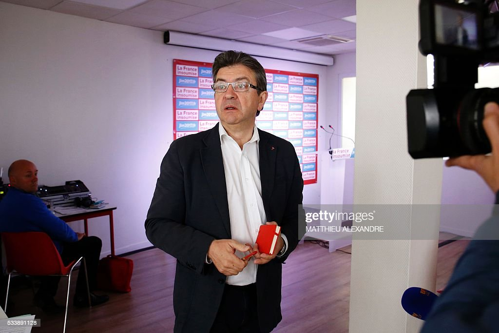 Member of European parliament for the French leftist Parti de Gauche (PG), founder of the 'La France Insoumise' (Unsubmissive France) movement, and candidate for the 2017 French presidential election, Jean-Luc Melenchon (2nd R), attends a press conference to present his programme ahead of the election, on May 24, 2016, in Paris. / AFP / MATTHIEU