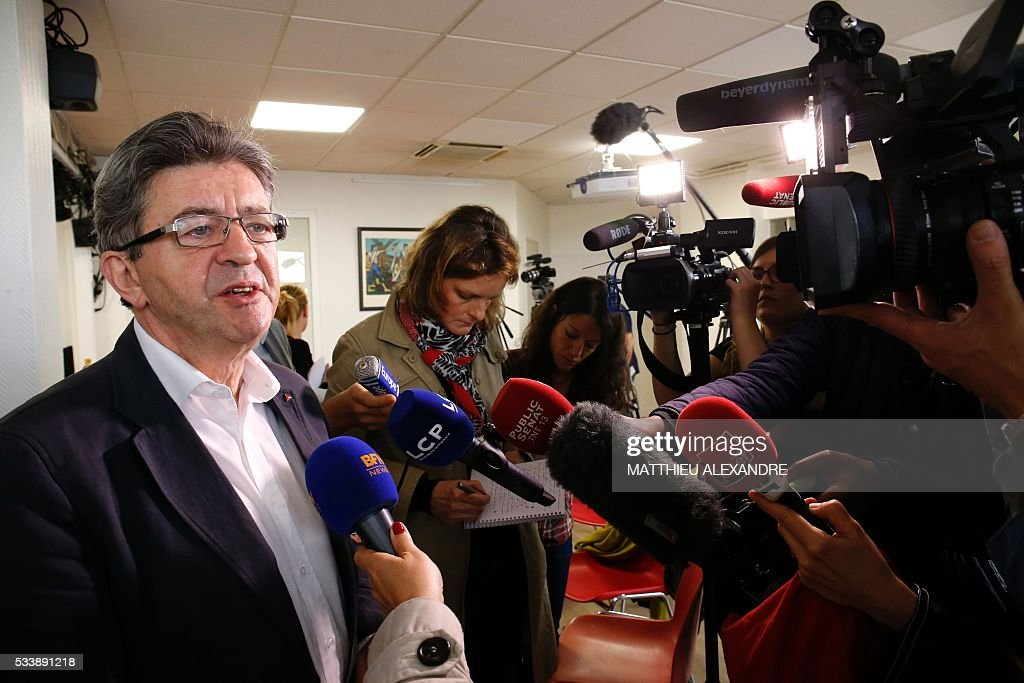 Member of European parliament for the French leftist Parti de Gauche (PG), founder of the 'La France Insoumise' (Unsubmissive France) movement, and candidate for the 2017 French presidential election, Jean-Luc Melenchon (2nd R), speaks to journalists during a press conference to present his programme ahead of the election, on May 24, 2016, in Paris. / AFP / MATTHIEU