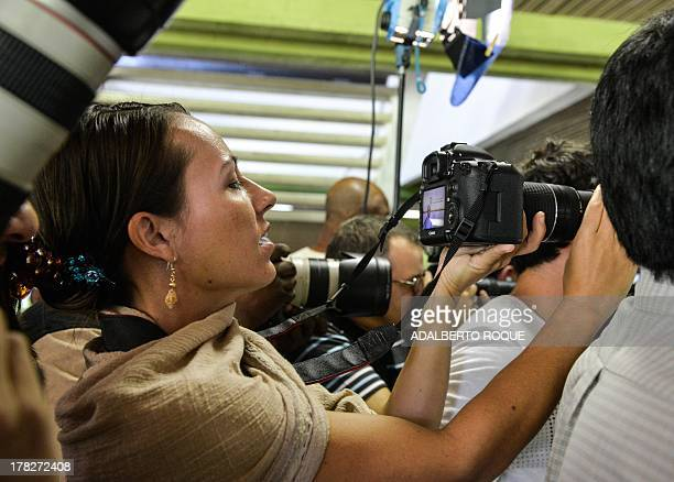 Member of FARCEP guerrillas delegation to the peace talks with the Colombian Government Dutch born Tanja Nijmeijer takes pictures from amidst the...