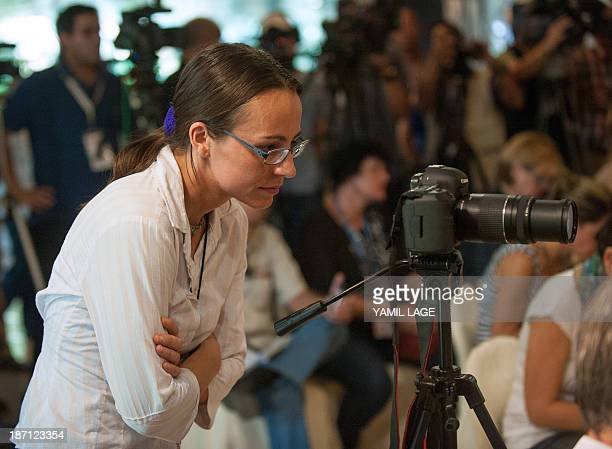 Member of FARCEP guerrillas delegation to the peace talks with the Colombian Government Dutch born Tanja Nijmeijer takes pictures at Convention...