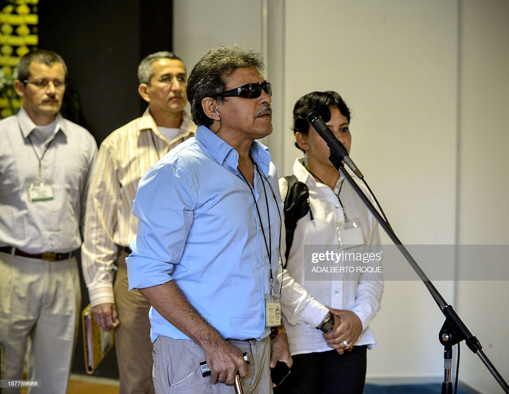 Member of FARC-EP leftist guerrillas delegation commander Jesus Santrich reads a statement at the Convention Palace in Havana for the peace talks with the Colombian government, on December 6, 2012.AFP PHOTO/ADALBERTO ROQUE