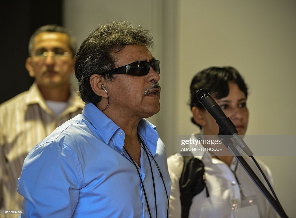 Member of FARC-EP leftist guerrillas delegation commander Jesus Santrich reads a statement at the Convention Palace in Havana for the peace talks with the Colombian government, on December 6, 2012.