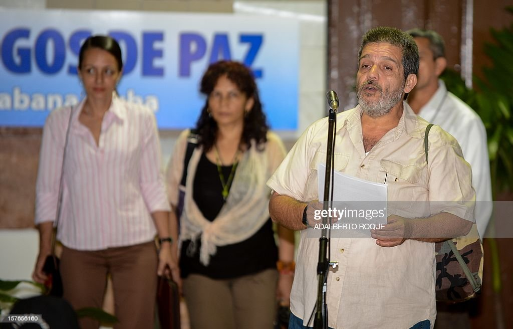 Member of FARC-EP leftist guerrillas delegation commander Marcos Calarca reads a statement at the Convention Palace in Havana for the peace talks with the Colombian government, on December 5, 2012.