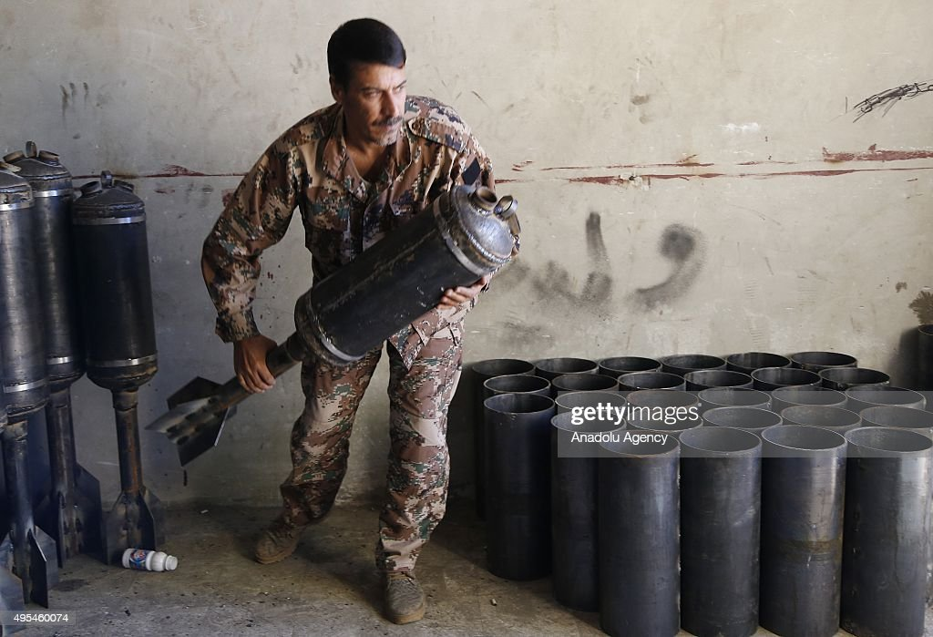 A Member of Feylek es-Sham group, a branch of Syrian opposition newly opens its workshop, carries a home made bomb in the country side of Aleppo, Syria on November 03, 2015.