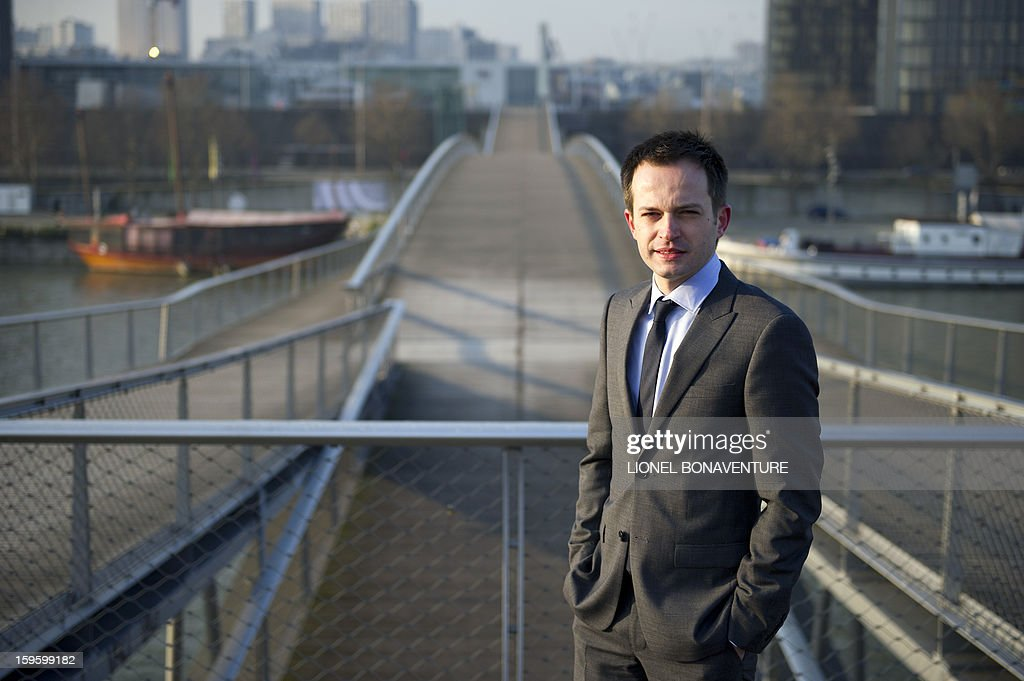 FRENCH - Member of France's right-wing party UMP and Paris' city councillor Pierre-Yves Bournazel poses on on the Simone de Beauvoir bridge in Paris on January 14, 2013. Bournazel officially announced on January 17, 2013 he is running for mayor in Paris in next year's municipal elections. AFP PHOTO / LIONEL BONAVENTURE