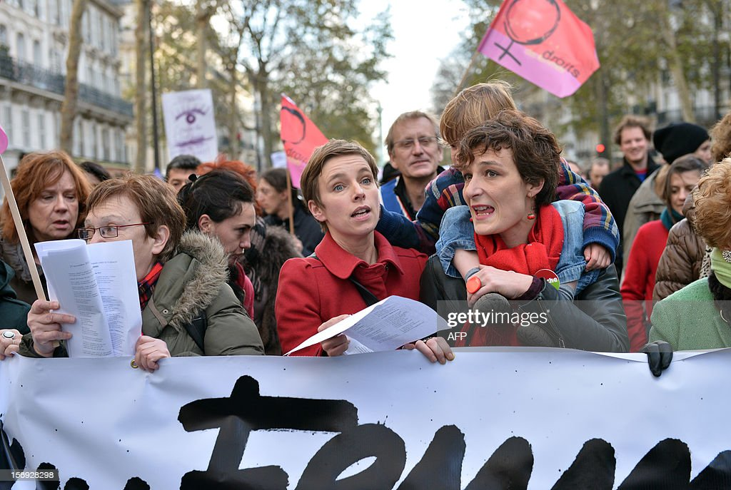 Member of French far left party Front de Gauche (FG) and co-editor of the French monthly magazine Regards, Clementine Autain (C) takes part in a demonstration called by the Women rights national collective, on November 25, 2012 in Paris, as part of the International Day for the Elimination of Violence Against Women. Since 1999, the United Nations each year invites governments, international organizations and NGOs to organize activities designed to encourage the public to fight such violence. Banner in the background reads: 'On November 25, support the fight against violence towards women.'.