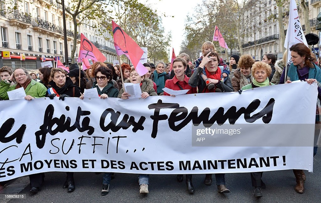 Member of French far left party Front de Gauche (FG) and co-editor of the French monthly magazine Regards, Clementine Autain (C) takes part in a demonstration called by the Women rights national collective, on November 25, 2012 in Paris, as part of the International Day for the Elimination of Violence Against Women. Since 1999, the United Nations each year invites governments, international organizations and NGOs to organize activities designed to encourage the public to fight such violence. Banner in the background reads: 'On November 25, support the fight against violence towards women.'. AFP PHOTO BERTRAND LANGLOIS