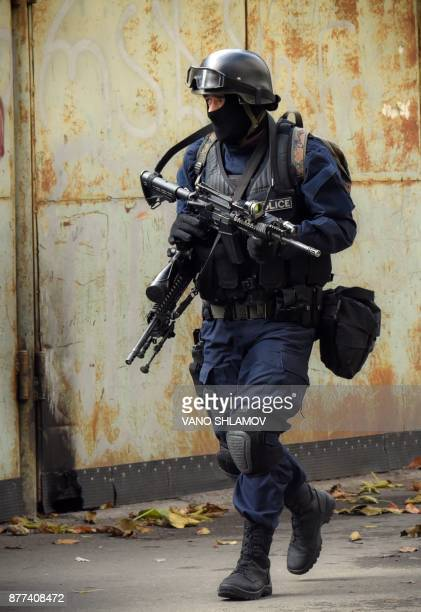 A member of Georgian armed counterterrorist unit takes part in a special operation around an apartment block in Tbilisi on November 22 2017...