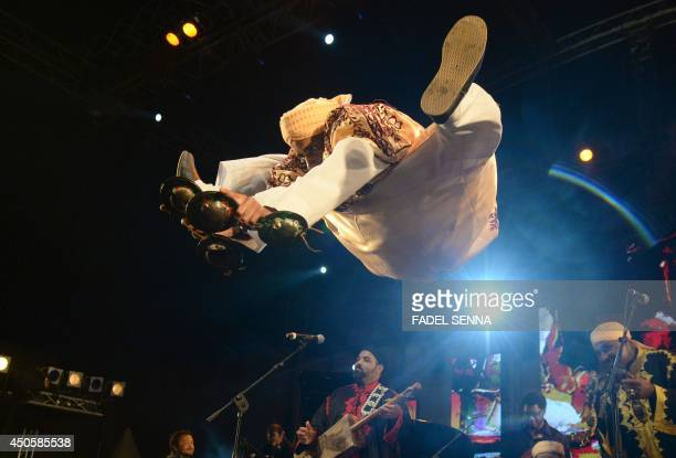 A member of Gnaoua group Maalem Mohamed kouyou performs in Essaouira at the Gnaoua World Music Festival on june 13 2014 The annual festival provides...