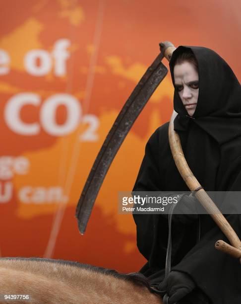 A member of Greenpeace demonstrate dressed as 'Death' one of the Four Horsemen of the Apocalypse on December 14 2009 in Copenhagen Denmark...