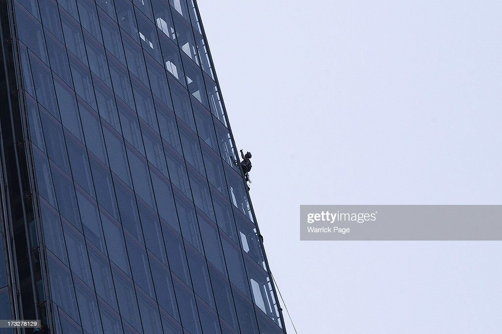 A member of Greenpeace gestures to a fellow climber while scaling the Shard, the tallest building in western Europe, on July 11, 2013, in London, England. The six female protesters began their unauthorised ascent of the 310 metre high skyscraper shortly after 4am with the intention of highlighting the environmental damage caused by drilling for oil in the Arctic by Shell.