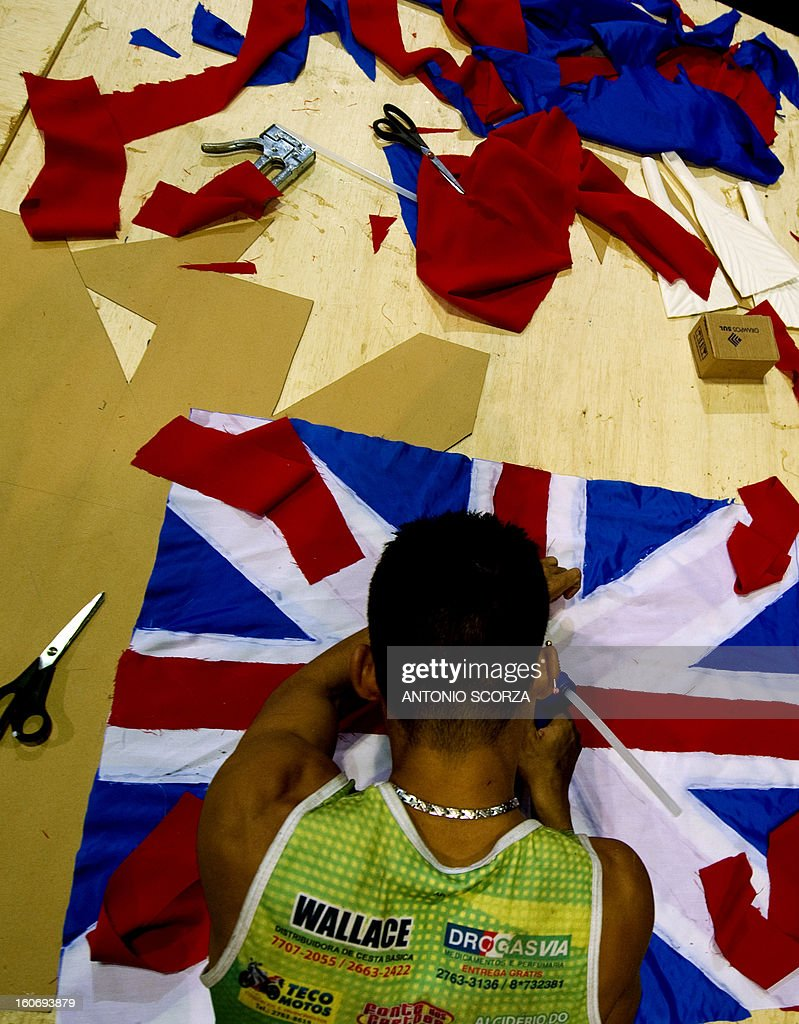 A member of Imperatriz Leopoldinense samba school makes a British flag during preparations for the famous carnival parade at the Sambodromo, on February 4, 2013 in Rio de Janeiro. The samba schools parade will be held next February 10 and 11.