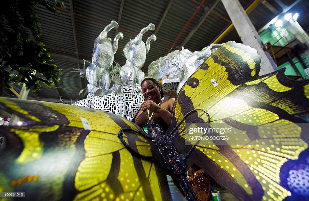 A member of Imperatriz Leopoldinense samba school works atop a float during preparations for the famous carnival parade at the Sambodromo, on February 4, 2013 in Rio de Janeiro. The samba schools parade will be held next February 10 and 11.