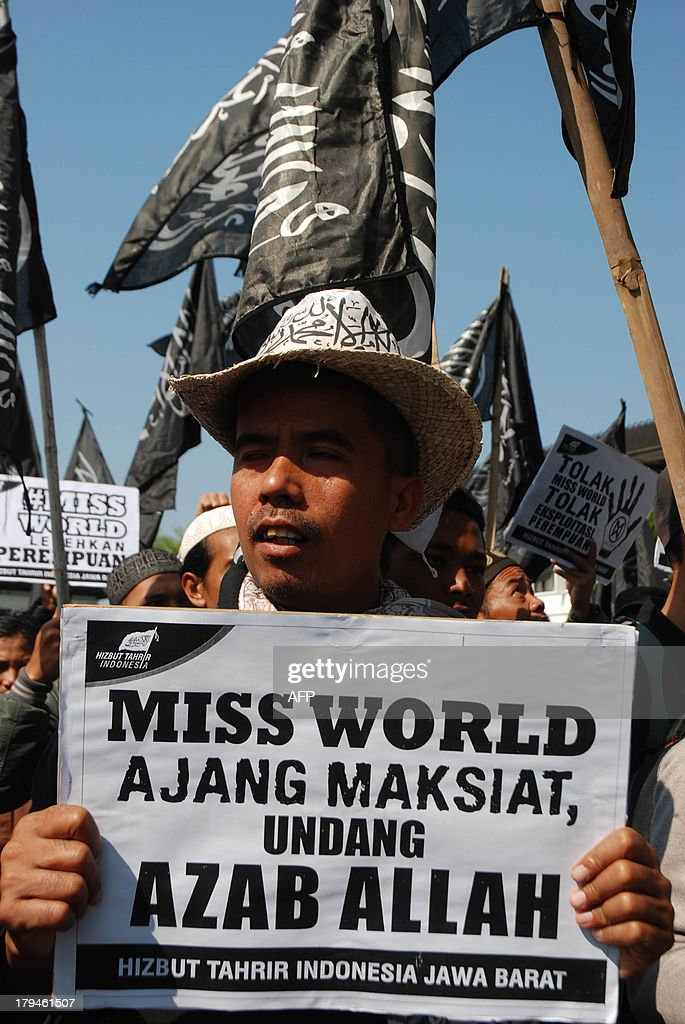 A member of Indonesia's Islamic conservative organisation Hizbut Tahrir holds a placard which traslates as 'Miss World is an immoral event and invites punishment from God' during a rally against the Miss World beauty pageant in Bandung city in western Java island on September 4, 2013 as Miss World 2013 contestants began arriving in Indonesia's resort island of Bali in time for the month long program. Anti-Miss World protest continue in the Muslim-majority nation ahead of the opening ceremony in Bali on September 8, 2013 in Bali and the finals in Sentul on September 28.