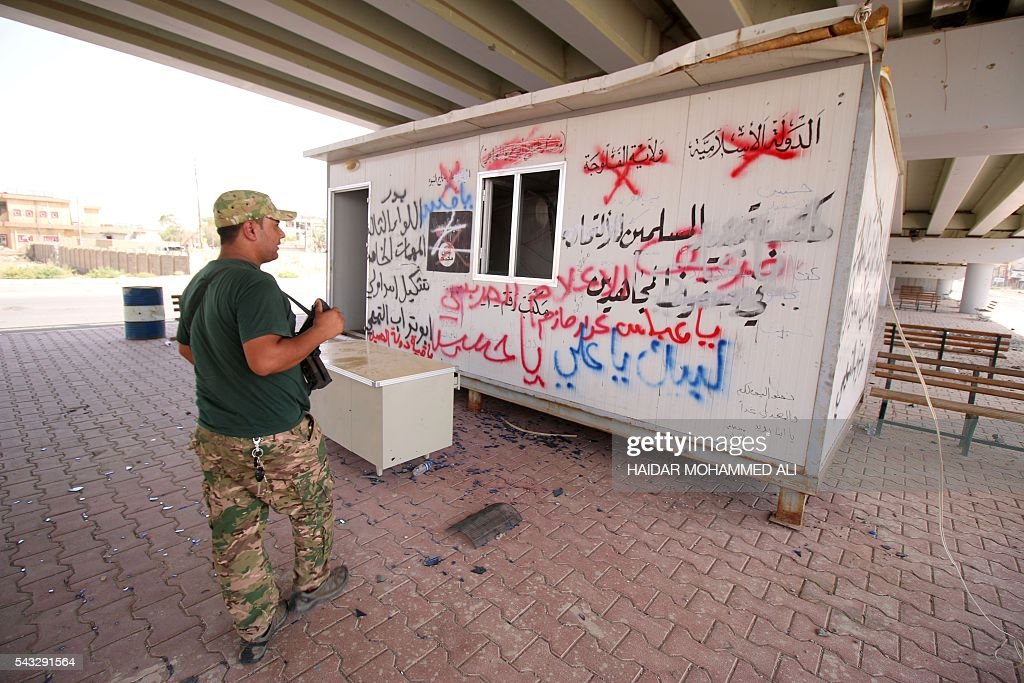 A member of Iraqi government forces patrols an area in western Fallujah, 50 kilometres (30 miles) from the Iraqi capital Baghdad, after Iraqi forces retook the embattled city from the Islamic State group on June 27, 2016. Iraqi forces took the Islamic State group's last positions in the city of Fallujah on June 26, 2016, establishing full control over one of the jihadists' most emblematic bastions after a month-long operation. ALI