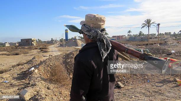 A member of Iraqi security forces holds a Rocket Propelled Grenade as he stands guard during an operation to clear alSajarya district on the eastern...