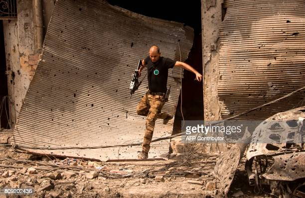 TOPSHOT A member of Iraq's CounterTerrorism Service advances in the Old City of Mosul on July 5 during the government forces' ongoing offensive to...