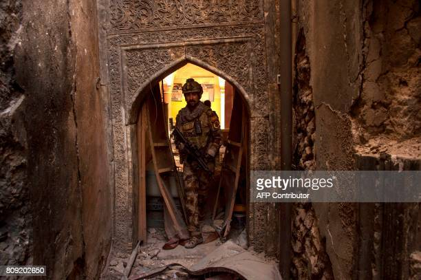 A member of Iraq's CounterTerrorism Service advances in the Old City of Mosul on July 5 during the government forces' ongoing offensive to retake the...