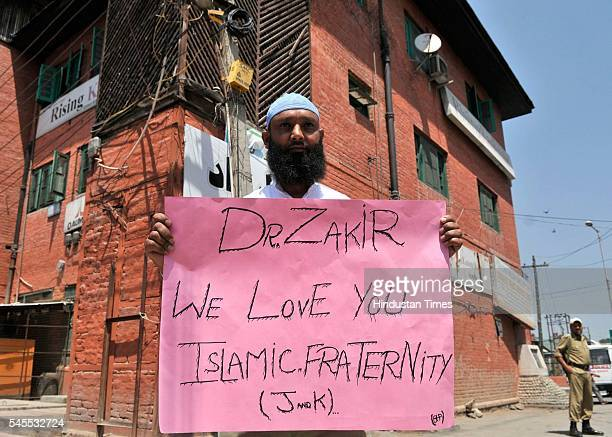 A member of Islamic Fraternity of Kashmir protests against the hounding of Islamic Preacher Dr Zakir Naik after allegations that one of the Dhaka...