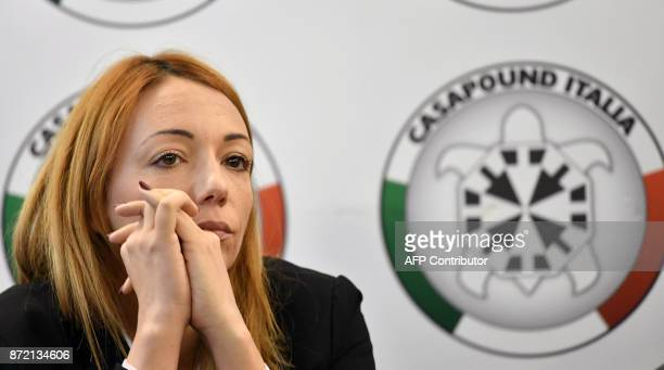 Member of Italy's farright CasaPound movement Carlotta Chiaraluce attends a press conference at CasaPound's headquarters in Rome on November 9 2017...