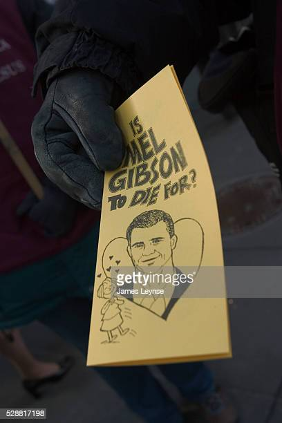 A member of 'Jews for Jesus' hands out a pamphlet in New York City's Times Square near a movie theater where Mel Gibson's 'The Passion of the Christ'...