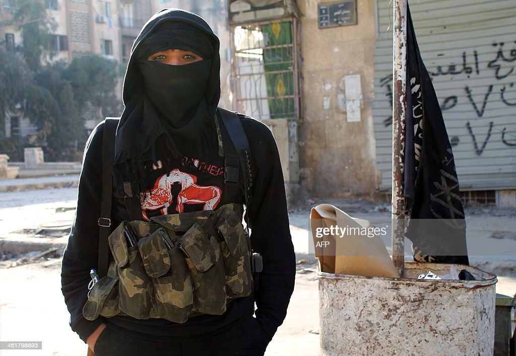 A member of jihadist group AlNusra Front stands in a street of the northern Syrian city of Aleppo on January 11 2014 Fighting pitting the Islamic...