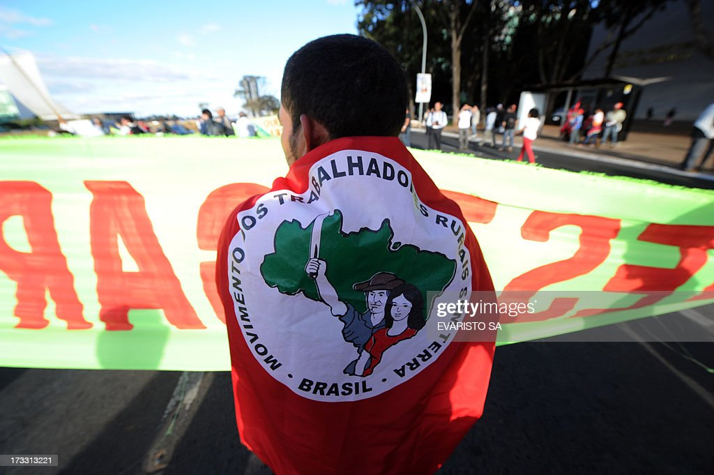 A member of Landless Movement (MST) takes part in a demonstration in front Itamaraty Palace in Brasilia, Brazil, on July 11, 2013 during a day of strikes and demonstrations called by the country's five leading labor federations to demand better public services and an end to endemic corruption.. AFP PHOTO/Evaristo Sa