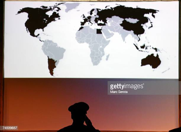 A member of Law Enforcement stands at attention in front of a map of the world at the Global Initiative to Combat Nuclear Terrorism International Law...